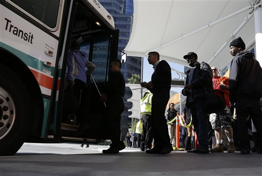 With the BART transit system on strike, people wait in line to board an express bus to Oakland, Calif., at the Transbay Terminal Friday, Oct. 18, 2013, in San Francisco. Commuters in the San Francisco Bay Area got up before dawn on Friday and endured heavy traffic on roadways, as workers for the region&#39;s largest transit system walked off the job for the second time in four months. About 400,000 riders take BART every weekday on the nation&#39;s fifth-largest commuter rail system. <span class=meta>( &#40;AP Photo&#47;Eric Risberg&#41;)</span>