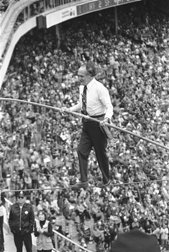 Flying Wallenda Family - Karl Wallenda has the fans attention as he walks a high wire across Candlestick Park in San Francisco on May 8, 1977 during intermission of double header between the New York Mets and San Francisco Giants.  <span class=meta>(AP Photo&#47;James Palmer)</span>