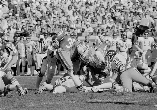 Running back Paul Hofer of the San Francisco 49ers hits the Chicago line for three yards during the second period at Candlestick Park in San Francisco, Oct. 28, 1979. Defending for the Bears are Gary Fencik, left, and Tom Hicks, on ground. <span class=meta>(AP Photo&#47;James Palmer)</span>