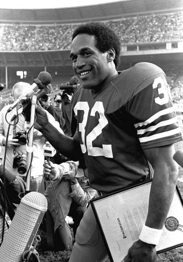 San Francisco running back O.J. Simpson, smiles as he acknowledges applause in San Francisco&#39;s Candlestick Park Sunday, Dec. 10, 1979. Simpson announced his retirement in pregame ceremonies. Then, the 49ers went out and downed Tampa Bay, 23-7, for their second victory season. <span class=meta>(AP Photo&#47;Paul Sakuma)</span>