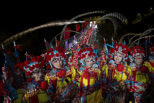 China New Year&#39;s Eve - Performers gather for a group photo after the end of a New Year&#39;s Eve count down to 2014 in Beijing, China, Wednesday, Jan. 1, 2014.  <span class=meta>(AP Photo&#47;Ng Han Guan)</span>