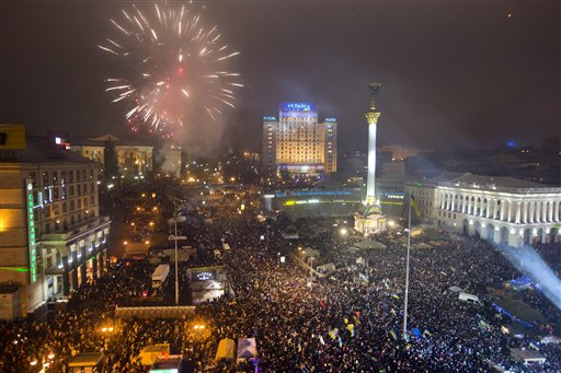Ukraine New Year&#39;s Eve - Fireworks explode as pro-European Union activists celebrate the New Year in the Ukrainian capital Kiev&#39;s main square early Wednesday, Jan. 1, 2014. At least 100,000 Ukrainians sang the country&#39;s national anthem together at the square on New Year&#39;s Eve in a sign of support for integration with Europe. Opposition leaders had called on Ukrainians to come to Kiev&#39;s Maidan on the New Year&#39;s Eve and sing the national anthem in an act of defiance and what they expected could be the record-breaking live singing of an anthem. <span class=meta>(AP Photo&#47;Efrem Lukatsky)</span>