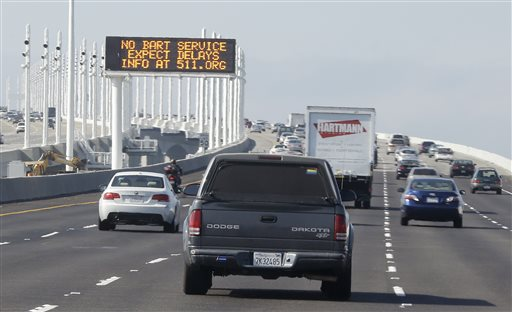 "<div class=""meta image-caption""><div class=""origin-logo origin-image ""><span></span></div><span class=""caption-text"">A traffic sign on the San Francisco-Oakland Bay Bridge alerts motorists to expect delays because of the BART transit strike Monday, Oct. 21, 2013, in Oakland, Calif. Frustrated San Francisco Bay Area commuters started the work week on Monday with gridlocked roadways and long lines for buses and ferries as a major transit strike entered its fourth day. (AP Photo/Eric Risberg)</span></div>"