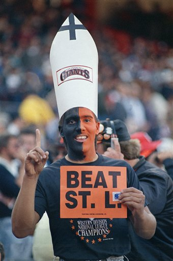 Sporting a black and orange paint job and a mitre, a faithful San Francisco Giants fan, shows his allegiance before a NLCS game against the St. Louis Cardinals at Candlestick Park, Friday, Oct. 9, 1987, San Francisco, Calif. Candlestick was also the site of a papal mass during the pontiffs visit to San Francisco in September. <span class=meta>(AP Photo&#47;Eric Risberg)</span>
