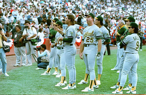 WORLD SERIES 1989 GIANTS - Members of the Oakland Athletics stand and stare as Candlestick Park-goers leave the stadium in the wake of the major earthquake that struck Northern California just before game 3 of the World Series against the San Francisco Giants on Oct. 17, 1989. <span class=meta>(AP Photo)</span>