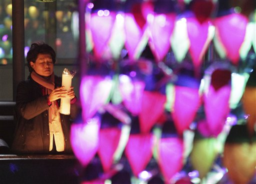 "<div class=""meta image-caption""><div class=""origin-logo origin-image ""><span></span></div><span class=""caption-text"">South Korea New Year's Eve - A Buddhist woman holding a candle light prays ahead of the new year at Chogye Buddhist temple in Seoul, South Korea, Tuesday, Dec. 31, 2013.  (AP Photo/Ahn Young-joon)</span></div>"