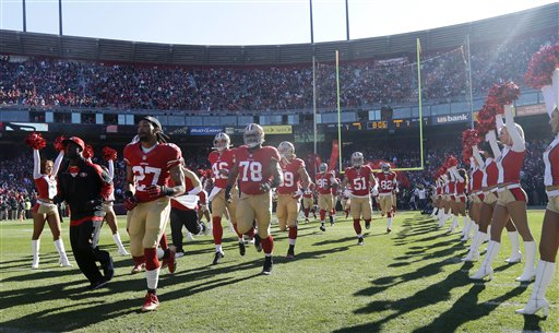 San Francisco 49ers players run into Candlestick Park during player introductions before an NFL football game against the Seattle Seahawks, Sunday, Dec. 8, 2013, in San Francisco.  <span class=meta>(AP Photo&#47;Marcio Jose Sanchez)</span>