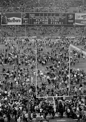 Hundreds of San Francisco 49ers fans romp on the playing field at Candlestick Park despite an appeal from the scoreboard after their team defeated the Chicago Bears 23-0 to capture the NFC championship in San Francisco, Jan. 6, 1985. The 49ers will face the Miami Dolphins in the Super Bowl in two weeks at nearby Stanford Stadium, where the San Francisco fans are expected to be equally enthusiastic. <span class=meta>(AP Photo&#47;Paul Sakuma)</span>