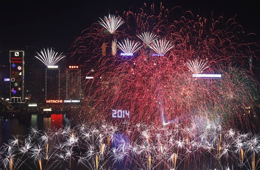 Hong Kong New Year&#39;s Eve - Fireworks explode at the Hong Kong Convention and Exhibition Centre over the Victoria Harbor during New Year&#39;s Eve to celebrate the start of 2014 in Hong Kong, Wednesday, Jan. 1, 2014  <span class=meta>(AP Photo&#47;Kin Cheung)</span>