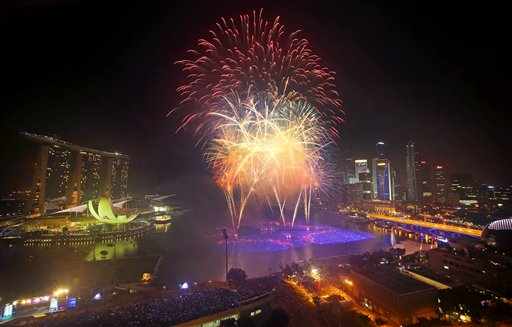 "<div class=""meta ""><span class=""caption-text "">Singapore New Year's Eve - Fireworks explode over the financial district at midnight, Wednesday, Jan. 1, 2014 in Singapore. Celebrations started on New Year's Eve where concerts were held and thousands gathered on the streets to usher in the Year 2014.  (AP Photo/Wong Maye-E)</span></div>"