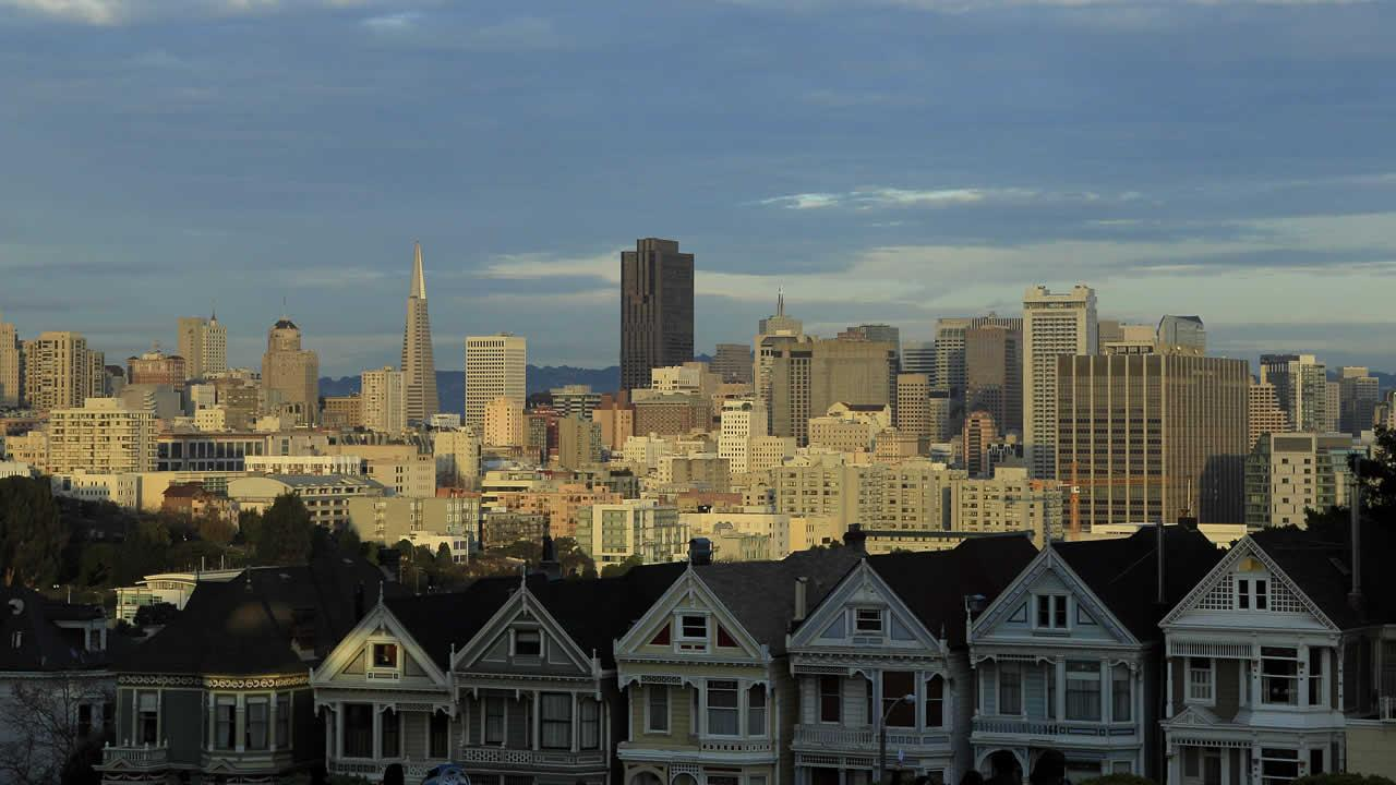 The San Francisco skyline is shown as the sun sets from Alamo Square Park in San Francisco, Wednesday, Dec. 28, 2011