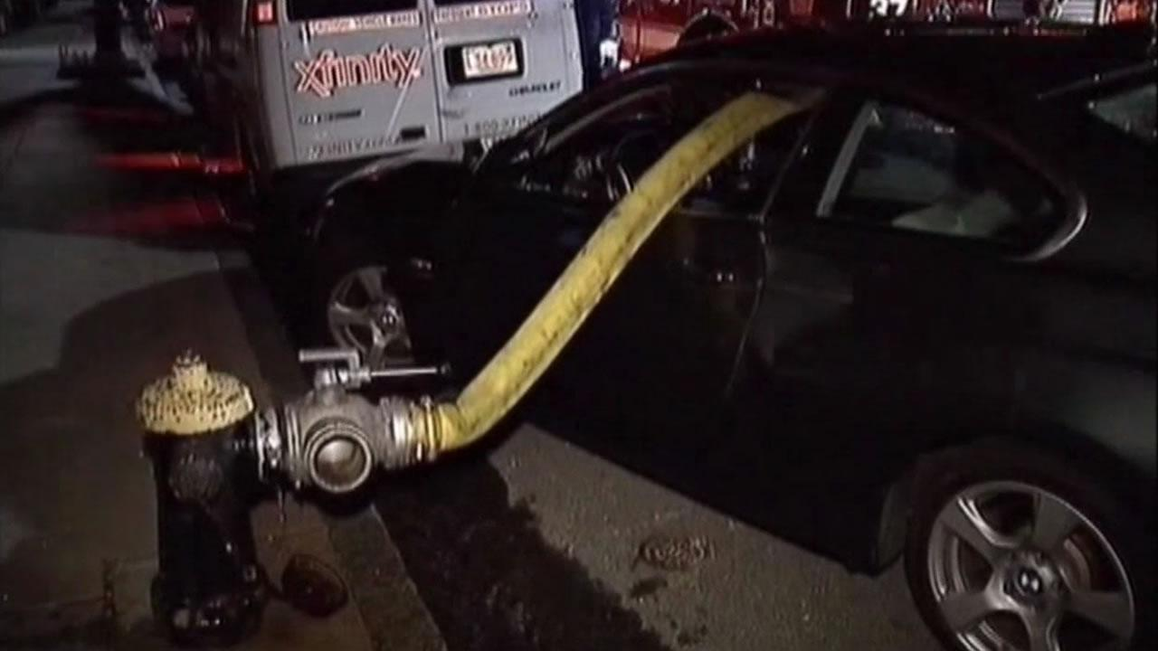 Boston firefighters last night did not let an illegally parked BMW in front of a fire hydrant stop them from doing their job.