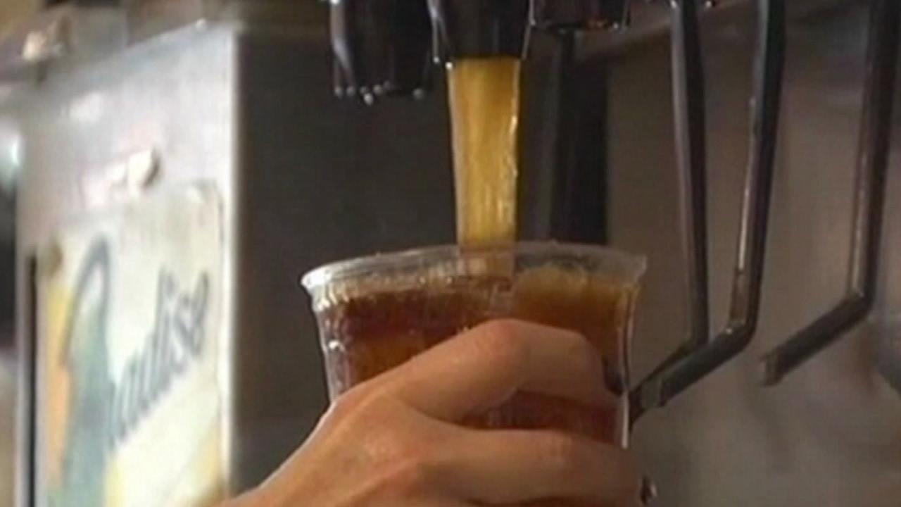 Soda machine drink refill.