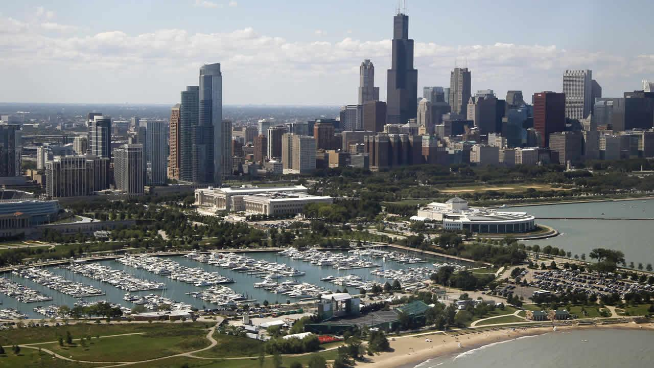 The Chicago skyline is seen from the media helicopter traveling with President Barack Obama to the landing zone, Saturday, Aug. 11, 2012, in Chicago.