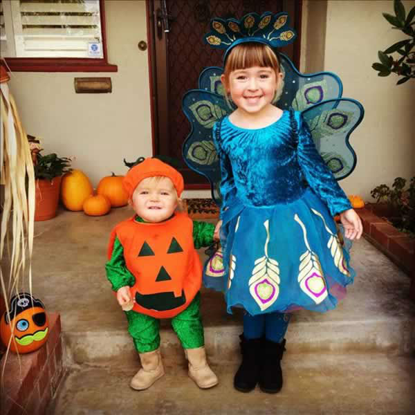 Kate, age 1, pumpkin Ellie, age 4, peacock (Submitted via uReport)