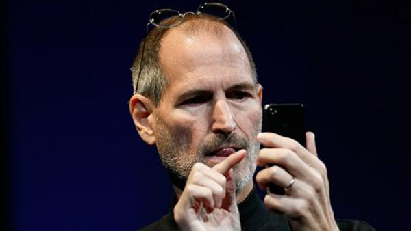 Apple CEO Steve Jobs uses the new iPhone during the Apple Worldwide Developers Conference