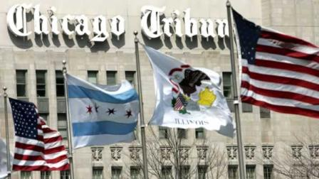 Flags wave along Michigan Ave. Bridge outside the Chicago Tribune Tower in Chicago in this, April 12, 2006, file photo.