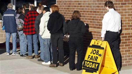 This Jan. 12, 2012 photo shows people waiting in line at a job fair employer hiring event for Safeway in Portland, Oregon.