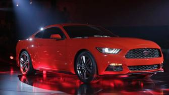 The latest Mustang of the Ford Motor Company is unveiled to the media at the All-New Ford Mustang Global Reveal event in Shanghai, China, Thursday, Dec. 5, 2013. (AP Photo/Eugene Hoshiko)