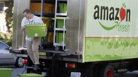 AmazonFresh delivery man Tim Wilkie prepares a grocery order for delivery to a residence on Mercer Island, Wash., Thursday, Aug. 23, 2007. (AP Photo/Joe Nicholson)