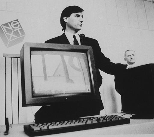 In this photo provided by NEXT, personal computer pioneer Steve Jobs gestures at a news conference, where he unveiled his Next computer workstation, as Texas billionaire H. Ross Perot, right, looks on, in San Francisco, Wednesday, Oct. 12, 1988. Jobs, the college dropout who co-founded Apple Computer, says the computer, into which Perot has invested more than &#36;20 million, will eventually sell for commercial use for about &#36;10,000. <span class=meta>(AP Photo&#47;NEXT, Doug Menuez)</span>