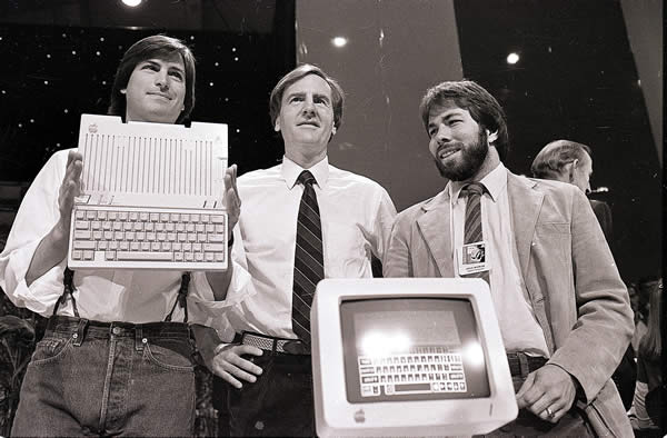 In this April 24, 1984 file photo, Steve Jobs, left, chairman of Apple Computers, John Sculley, center, then president and CEO, and Steve Wozniak, co-founder of Apple, unveil the new Apple IIc computer in San Francisco. Apple Inc. on Wednesday, Aug. 24, 2011 said Jobs is resigning as CEO, effective immediately. He will be replaced by Tim Cook, who was the company&#39;s chief operating officer. It said Jobs has been elected as Apple&#39;s chairman. <span class=meta>(AP Photo&#47;Sal Veder)</span>