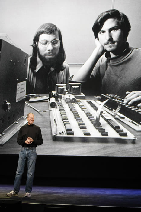 In this file photo taken Jan. 27, 2010 file photo, Apple CEO Steve Jobs stands in front of a photo of himself, right, and Steve Wozniak, left, during an Apple event in San Francisco. Apple Inc. on Wednesday, Aug. 24, 2011 said Jobs is resigning as CEO, effective immediately. He will be replaced by Tim Cook, who was the company&#39;s chief operating officer. It said Jobs has been elected as Apple&#39;s chairman <span class=meta>(AP Photo&#47;Paul Sakuma)</span>