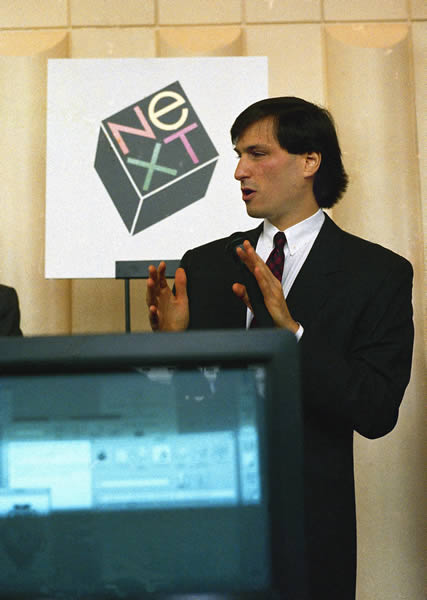 In this photo provided by NEXT, personal computer pioneer Steve Jobs gestures at a news conference in San Francisco, where he unveiled his Next computer workstation, in San Francisco, Wednesday, Oct. 12, 1988. Jobs, who co-founded Apple Computer, plans to sell the Next computer for about &#36;10,000. <span class=meta>(AP Photo&#47;NEXT, Doug Menuez)</span>