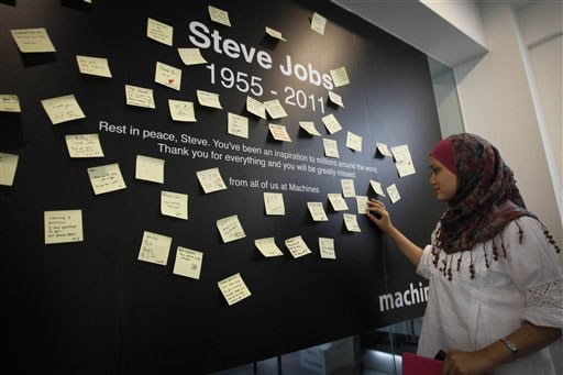"<div class=""meta image-caption""><div class=""origin-logo origin-image ""><span></span></div><span class=""caption-text"">A Malaysian reads condolent notes to pay tribute to Steve Jobs, the Apple founder and former CEO, at an Apple computer outlet in Kuala Lumpur, Malaysia, Thursday, Oct. 6, 2011. Jobs died peacefully on Wednesday, according to a statement from family members who were present. He was 56.  (AP Photo/Vincent Thian)</span></div>"