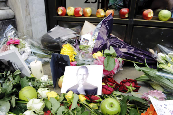 Tributes to Apple Computer co-founder Steve Jobs are placed outside The Apple Store in Regent Street in London. Jobs, 56, passed away after a long battle with pancreatic cancer. Jobs co-founded Apple in 1976 and is credited, along with Steve Wozniak, with marketing the world&#39;s first personal computer, Thursday, Oct. 6, 2011. <span class=meta>(AP Photo&#47;Jonathan Short)</span>