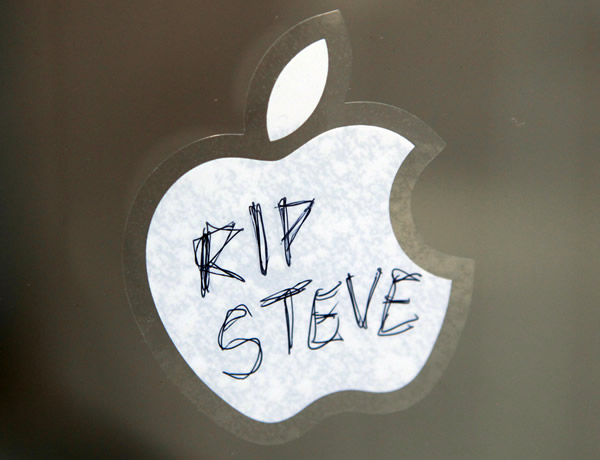 A condolence message on an Apple logo sticker adheres to the window of an Apple store in downtown Philadelphia Thursday Oct. 6, 2011. The Apple co-founder and former CEO Steve Jobs died Wednesday at the age of 56.  <span class=meta>(AP Photo&#47;Jacqueline Larma)</span>