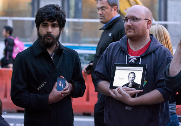 "<div class=""meta ""><span class=""caption-text "">Fred Velez, left, and Cory Moll, both of San Francisco, hold Apple devices with pictures of Steve Jobs displayed outside an Apple store in San Francisco, Wednesday, Oct. 5, 2011. Jobs, the Apple founder and former CEO who invented and masterfully marketed ever-sleeker gadgets that transformed everyday technology, from the personal computer to the iPod and iPhone, died Wednesday. He was 56. Apple announced his death without giving a specific cause. He died peacefully, according to a statement from family members who said they were present. ( AP Photo/Darryl Bush)</span></div>"