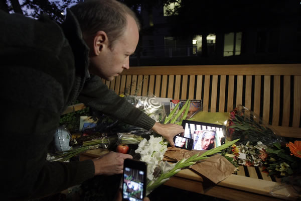 Jim Bryson, an Apple enthusiast, places Apple products on a makeshift shrine following the death of Steve Jobs at Apple headquarters Wednesday, Oct. 5, 2011 in Cupertino, Calif. Jobs, the Apple founder and former CEO who invented and masterfully marketed ever-sleeker gadgets that transformed everyday technology, from the personal computer to the iPod and iPhone, has died. He was 56.  <span class=meta>(AP Photo&#47;Marcio Jose Sanchez)</span>