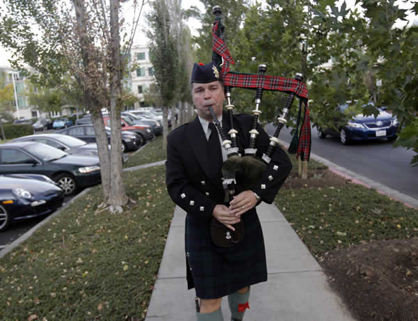 Richard Charette plays the bagpipes in honor of Steve Jobs at Apple headquarters Wednesday, Oct. 5, 2011 in Cupertino, Calif. Jobs, the Apple founder and former CEO who invented and masterfully marketed ever-sleeker gadgets that transformed everyday technology, from the personal computer to the iPod and iPhone, has died. He was 56. <span class=meta>(AP Photo&#47;Marcio Jose Sanchez)</span>