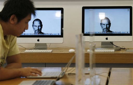 Portraits of the late Steve Jobs, co-founder of Apple Inc., illuminate computer monitors in an Apple retail store, in Taipei, Taiwan, Thursday, Oct. 6, 2011. Taiwanese rivals and partners of Apple Inc. lauded company founder Steve Jobs on Thursday, and news of his death dominated television coverage in the high-tech powerhouse. <span class=meta>( AP Photo&#47;Wally Santana)</span>