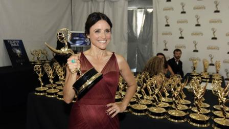 Actress Julia Louis-Dreyfus, winner of the Emmy for Outstanding Lead Actress in a Comedy Series for Veep, poses backstage at the 64th Primetime Emmy Awards at the Nokia Theatre on Sunday, Sept. 23, 2012, in Los Angeles. (Photo by Matt Sayles/Invision/AP)
