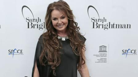 British soprano singer Sarah Brightman listens journalists during news conference in Moscow, Russia, Wednesday, Oct. 10, 2012.