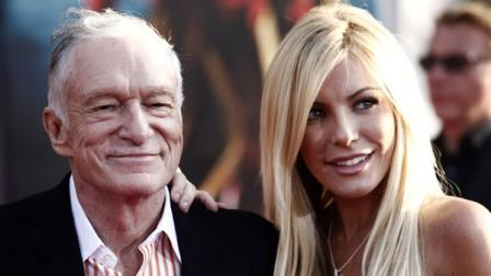 In this April 26, 2010 file photo, Hugh Hefner, left, and Crystal Harris arrive at the premiere of Iron Man 2 at the El Capitan Theatre in Los Angeles. Hefner and Harris obtained a marriage license in Beverly Hills, Calif. on Tuesday Dec. 4, 2012, roughly a year-and-a-half after the centerfold called off the couples previous engagement. (AP Photo/Matt Sayles, File)
