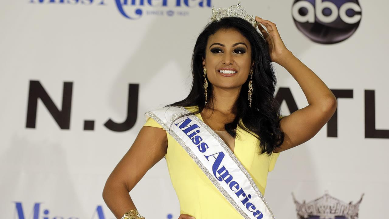Miss New York Nina Davuluri poses for photographers following her crowning as Miss America 2014, Sunday, Sept. 15, 2013, in Atlantic City, N.J.