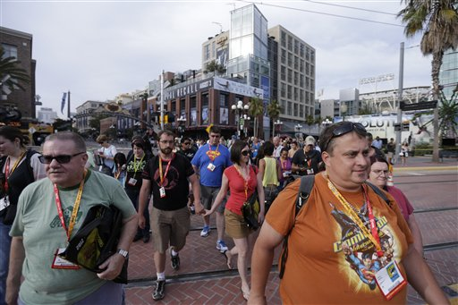 "<div class=""meta ""><span class=""caption-text "">Crowds of fans arrive to Comic-Con Wednesday, July 11, 2012, in San Diego. The annual comic book and popular arts convention attracts over 100,000 people and runs through July 15. (AP Photo/Gregory Bull)</span></div>"