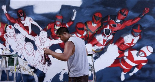 The artist Swank One grabs a towel as he paints Power Rangers on a wall near Comic-Con Wednesday, July 11, 2012, in San Diego. The annual comic book and popular arts convention attracts over 100,000 people and runs through July 15.  <span class=meta>(AP Photo&#47;Gregory Bull)</span>
