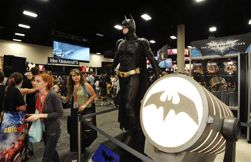 "<div class=""meta ""><span class=""caption-text "">Fans walk past a Batman figure at the San Diego Convention Center during preview night at Comic-Con on Wednesday July 11, 2012, in San Diego. (Photo by Denis Poroy/Invision/AP)</span></div>"