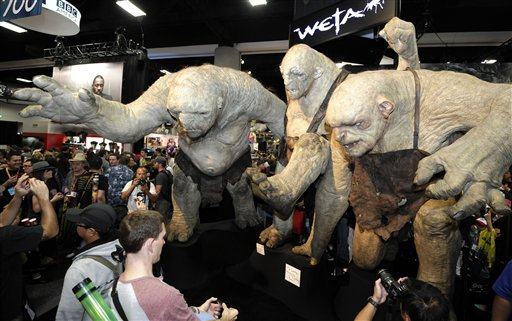 Fans walk past huge Stone Troll figures from the Lord of the Rings at the Comic-Con preview night held at the San Diego Convention Center on Wednesday July 11, 2012, in San Diego. <span class=meta>(Photo by Denis Poroy&#47;Invision&#47;AP)</span>