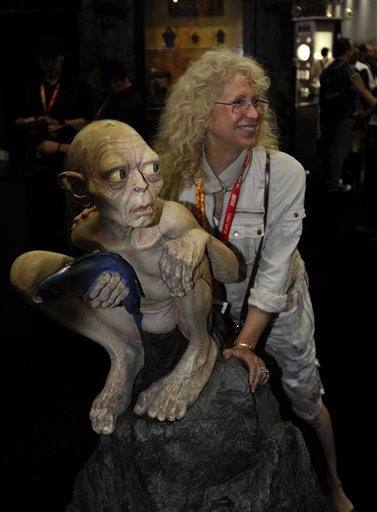 A fan poses with a Gollum figure from the Lord of the Rings at the Comic-Con preview night held at the San Diego Convention Center on Wednesday July 11, 2012, in San Diego. <span class=meta>(Photo by Denis Poroy&#47;Invision&#47;AP)</span>