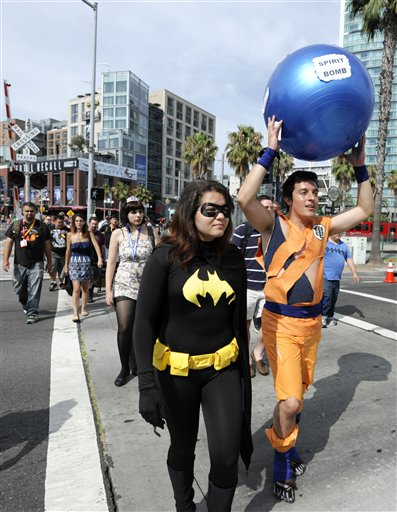 "<div class=""meta ""><span class=""caption-text "">Fans arrive at the San Diego Convention Center before preview night at Comic - Con on Wednesday July 11, 2012, in San Diego.  (Photo by Denis Poroy/Invision/AP)</span></div>"