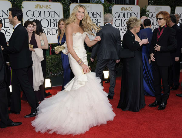 Elle Macpherson arrives at the 69th Annual Golden Globe Awards Sunday, Jan. 15, 2012, in Los Angeles. (AP Photo/Chris Pizzello)