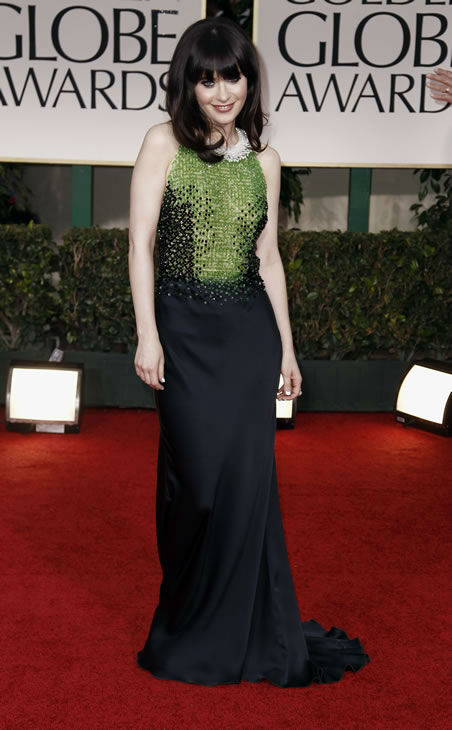Zooey Deschanel arrives at the 69th Annual Golden Globe Awards Sunday, Jan. 15, 2012, in Los Angeles. (AP Photo/Matt Sayles)