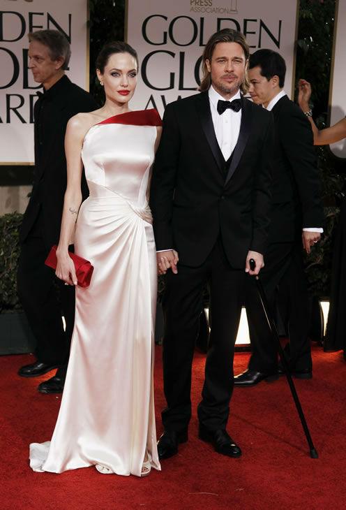 "<div class=""meta image-caption""><div class=""origin-logo origin-image ""><span></span></div><span class=""caption-text"">Angelina Jolie, left, and Brad Pitt arrive at the 69th Annual Golden Globe Awards Sunday, Jan. 15, 2012, in Los Angeles. (AP Photo/Matt Sayles)</span></div>"