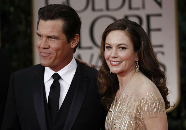 Josh Brolin, left, and Diane Lane arrive at the 69th Annual Golden Globe Awards Sunday, Jan. 15, 2012, in Los Angeles. (AP Photo/Matt Sayles)