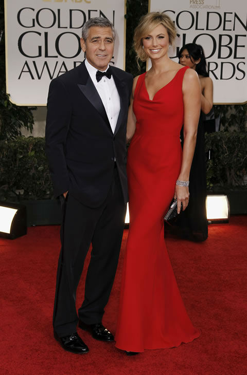 George Clooney, left, and Stacy Keibler arrive at the 69th Annual Golden GlobeAwards Sunday, Jan. 15, 2012, in Los Angeles. (AP Photo/Matt Sayles)